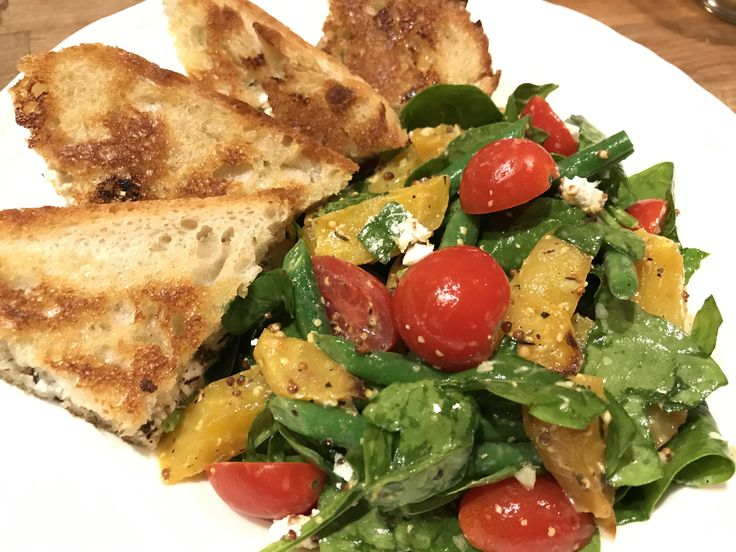 For a fun variation of the traditional grilled cheese, how about this toasted herbed goat cheese & honey sandwhich with a side of roasted golden beet, haricot vert and baby spinach salad? Serve this with a cold glass of your favorite buttery chardonnay and you'll be on your way to your happy place in no time! Learn more at: https://www.platecations.com/sin…/ToastedGoatCheeseSandwhich