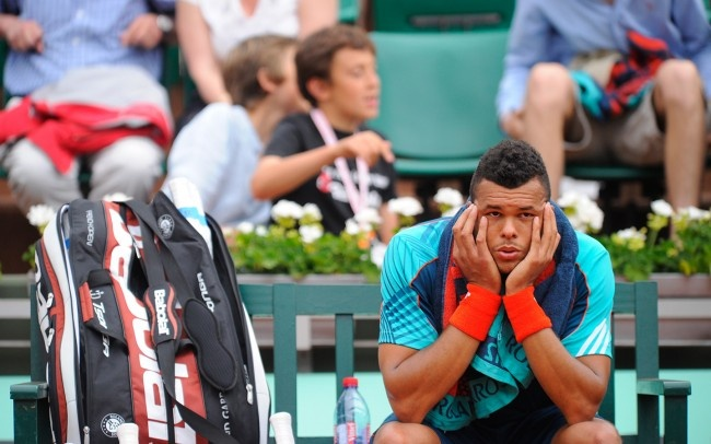 Tsonga looking as he's not there.