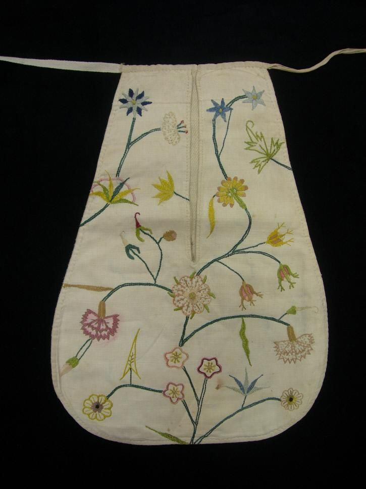1770-1800 pocket. Silk needlework on tabby-weave linen, cotton/linen backing and linen tape. Made from re-used embroidered fabric, not originally embroidered in pocket shape.  Colonial Williamsburg, 1958-409
