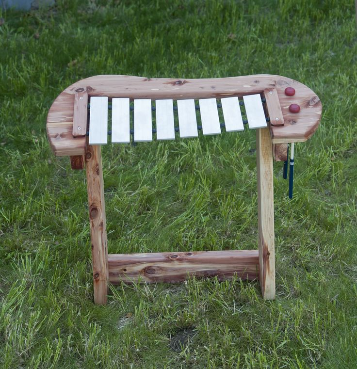 http://adventurouschild.com/xylophone.php Create a musical preschool playground with an outdoor xylophone!  This xylophone is made with cedar and was specially designed for a natural playscape. #playoutdoors