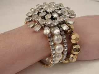 Use a Brooch clasps around several bracelets to make a sparkling piece of multi-strand jewelry !!