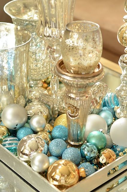 Winter holiday baubles used for tablescape blue gold