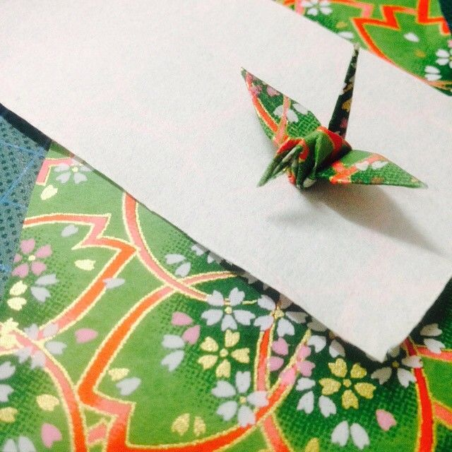Crane: the symbol of longevity, happiness, good fortune, and peace. #origami #OrientalArt #beauty #happiness #goodfortune #peace #crane #prayer #Japanese #madeinJapan #bird #green #paper #white #craft #red #pink #gold #shadow #love #hope