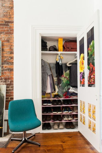 Make the most of a small, shallow closet by outfitting it with components that make sense. Instead of one long hanging rod, go with a pair of shorter valet rods to hang clothes boutique-style. Fill in all the extra space above and below the rods with shelving for shoes, accessories and sweaters, and install hooks under the shelves to hold bags or scarves.