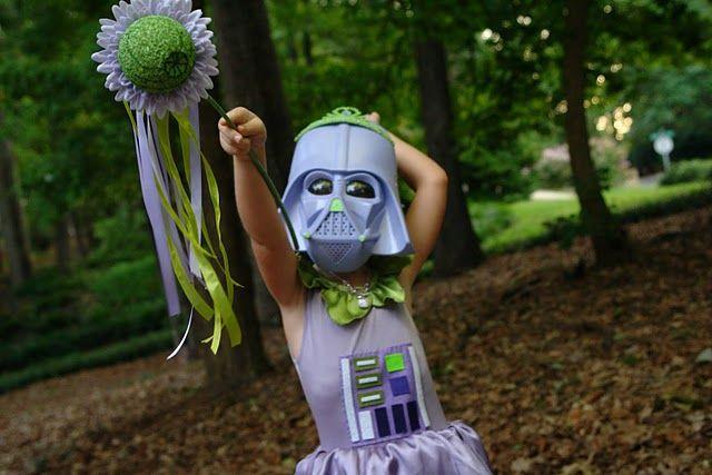 Darth fairy's wand has a green Death Star in it...