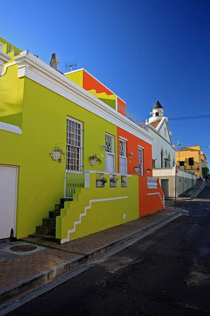 Bo-Kaap (South Africa). 'Painted in vivid colours straight out of a packet of liquorice allsorts, the jumble of crumbling and restored heritage houses and mosques along the cobblestoned streets of the  Bo-Kaap are visually captivating.' http://www.lonelyplanet.com/south-africa/cape-town/sights/museum/bo-kaap-museum