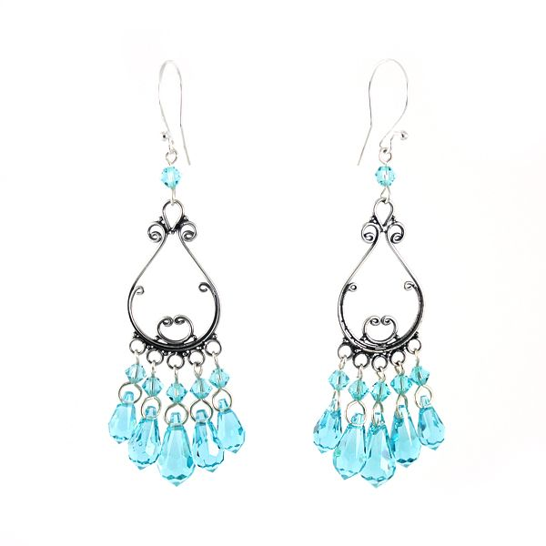 Turquoise guilty pleasures :). Fantastic shade of blue, sparkling Swarovski cystals and silver. Long, charismatic earrings.
