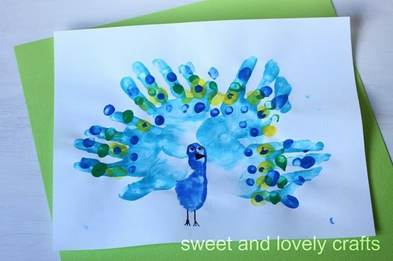 Peacock hand prints - k so all these art projects that I am suggesting - I want picts of them at least... and I'd like it if Angela could make me like 834798579 xmas ornaments out of her paintings to be delivered before xmas for my tree. K? lol