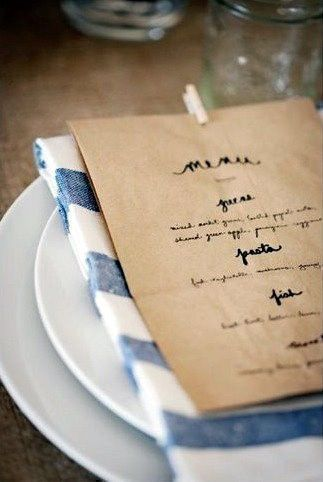 wedding menu on a brown bag clothes pinned to the napkin; so cute