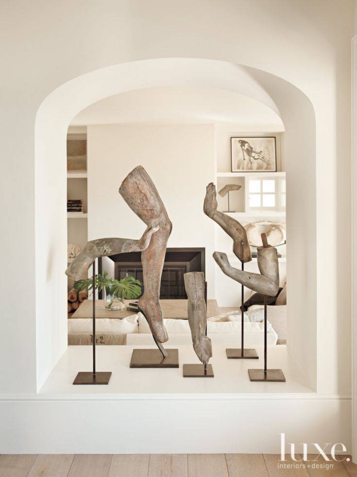 Living Room Arch Decorations: Sculptures In The Dining-to-living-room Open Arch