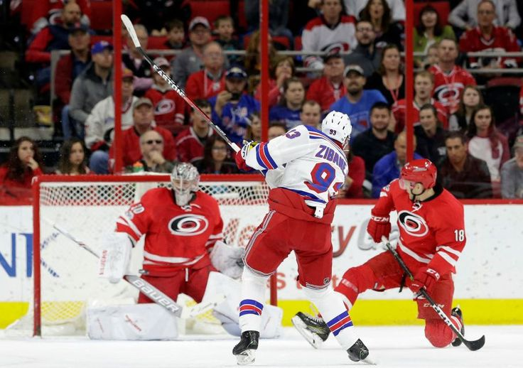 Rangers vs. Hurricanes:  March 9, 2017  -  The Rangers fell to the Carolina Hurricanes, 4-3, on Thursday at PNC Arena:     New York Rangers' Mika Zibanejad (93), of Sweden, scores against Carolina Hurricanes goalie Cam Ward (30) as Hurricanes' Jay McClement (18) defends during the second period of an NHL hockey game in Raleigh, N.C., Thursday, March 9, 2017.