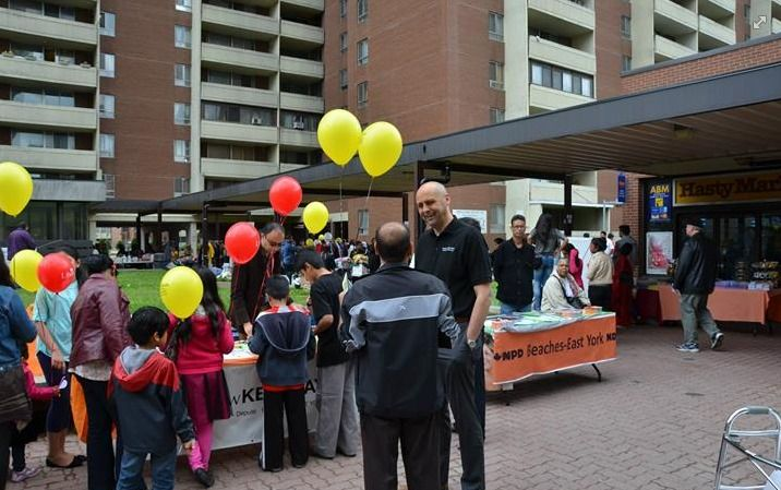 Beaches-East York MP Matt Kellway talks with a constituent at the fair.