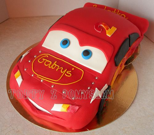 An awesome Lightning McQueen cake. GO CARS!