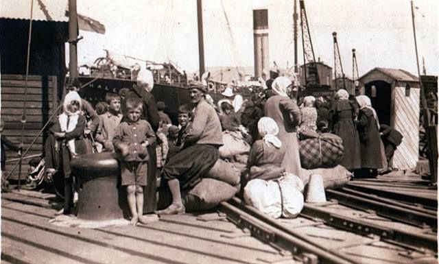 Refugees from the interior of Asia Minor await to board ships at the port of Smyrna. It is worth noting there are only old men, women and children, all males between the ages of 15-60 having been sent into the interior and massacred. (August 1922).