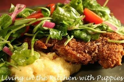 Veal Milanese with arugula salad, over soft polenta with marscapone ...