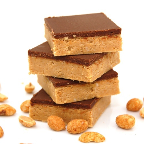 Peanut Butter Cup Bars. Made with butter, powdered sugar, creamy peanut butter, graham cracker crumbs, butter, and milk chocolate chips.