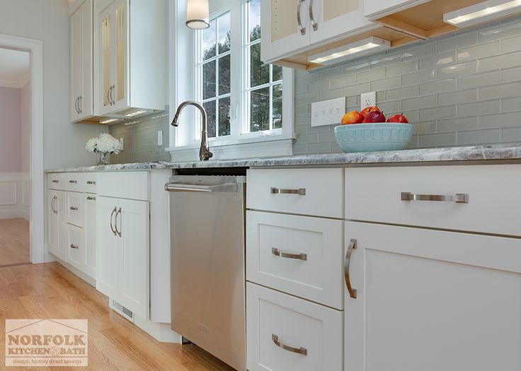 This kitchen remodel by Showplace was designed by Cathy from our Nashua showroom. This transitional kitchen remodel features a white Shaker style door with granite countertops, a gray tile backsplash and stainless steel appliances. This kitchen was part of a new home construction in Bedford, MA