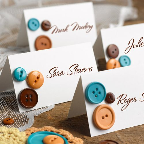 Easy DIY escort cards...just glue on a few vintage buttons in your wedding colors for an adorable touch!