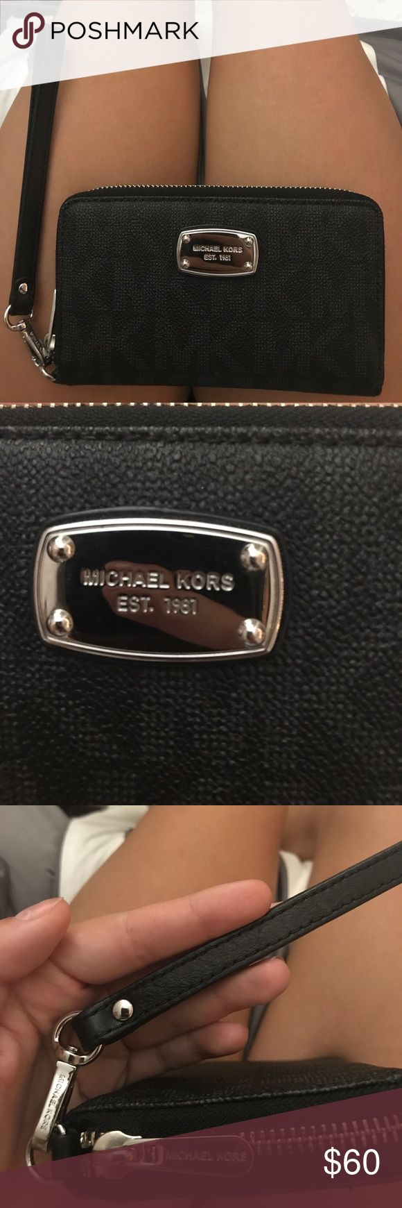 Michael Kors Logo Wallet Wristlet Black logo Michael Kors wallet with clip for wristlet. Card slots and spot for ID along with two pockets the length of the wallet. Easily fits an iPhone 7. Perfect condition. Bundle with matching bag for an extra discount. Michael Kors Bags Wallets