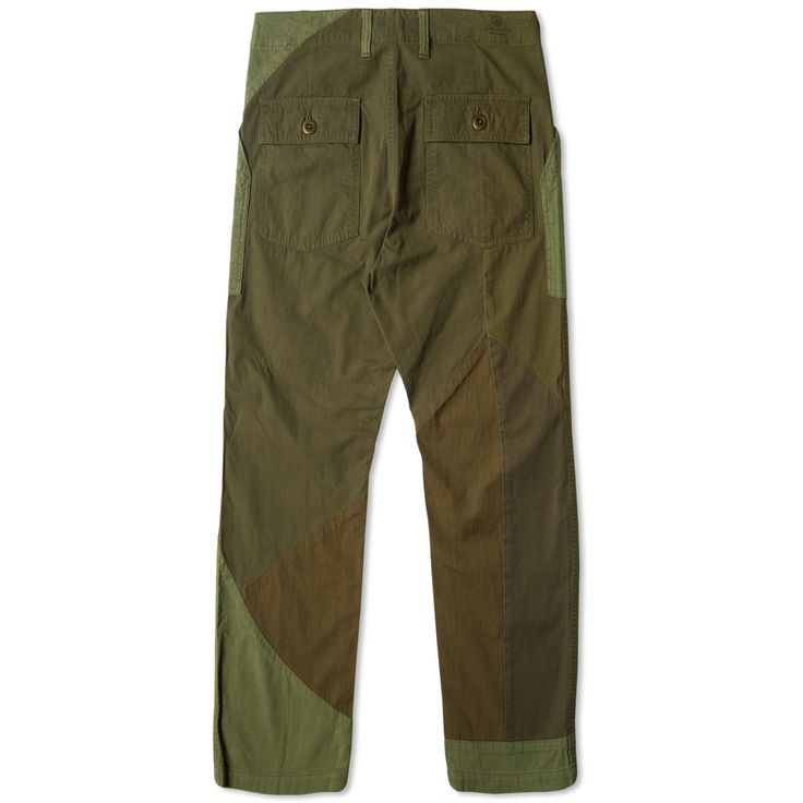 Sasquatchfabrix. Is the creation of a Japanese design collective – Wonder Worker Guerrilla Band. Their aesthetic is firmly rooted in skate and graffiti culture, designing pieces to bridge the gap between the avant-garde and a more wearable streetwear styling. The Peaceful Fatigue Pant are crafted from a cotton twill fabric in a series of military green tones.  100% Cotton Twill Two Front Pockets Button Closure Back Pockets Contrast Panel Construction Zip Fly & Button Waistband