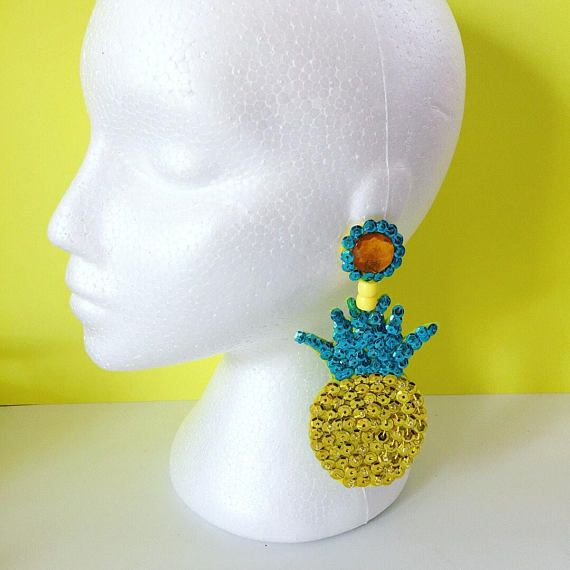 Hand Embroidered Earrings These stunning and incredibly sparkly pineapple sequin dangle earrings are made with surgical steel, hypo-allergenic studs. They are very light weight because of the materials used, being made with sequins that are hand sewn onto felt, with beads.