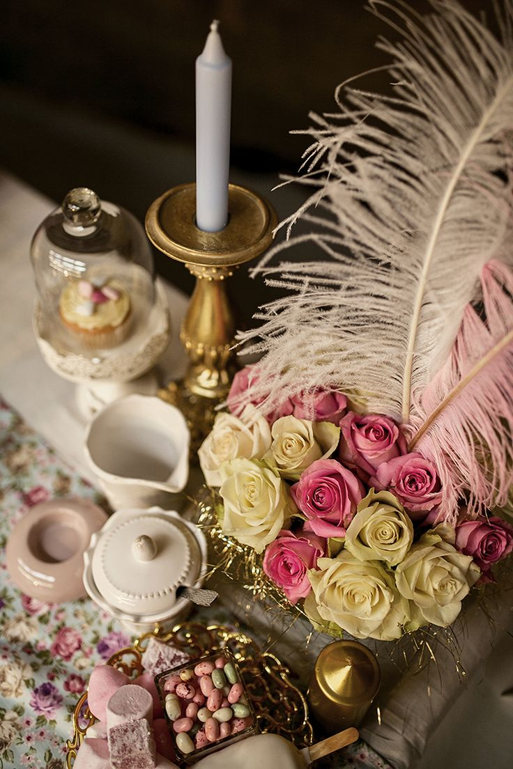 The floral pieces contained a range of pastel coloured roses. See how random tea-time pieces finishes the look off.
