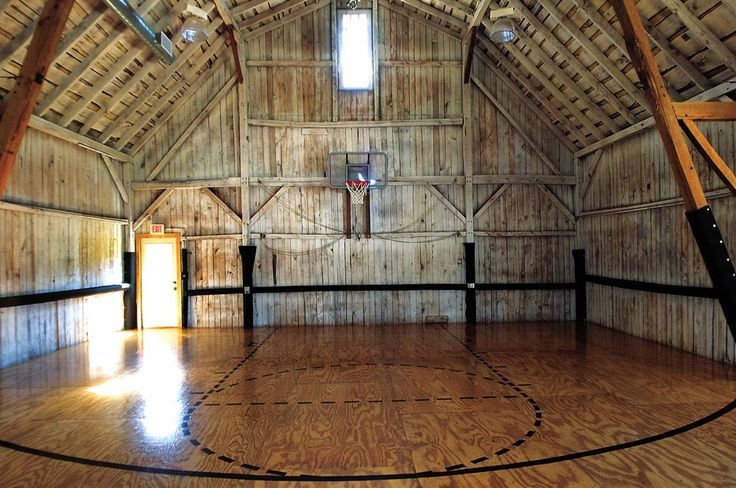 Restored camp has basketball court in a barn