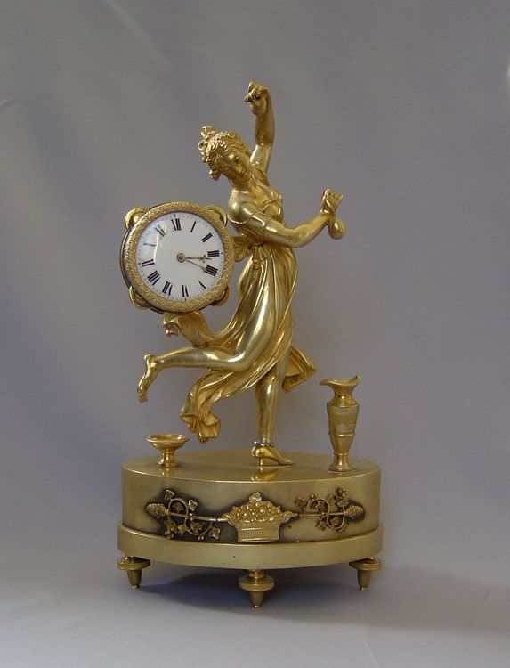 A lovely and rare model of the famous small mantel clock in original ormolu of the Dancing Bacchante or Mae