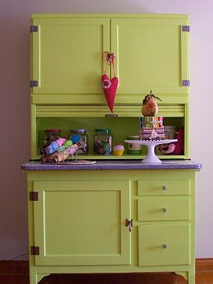 Hoosier cabinet, almost like mine except the center doors pull together with two doors, versus the pull down center door.