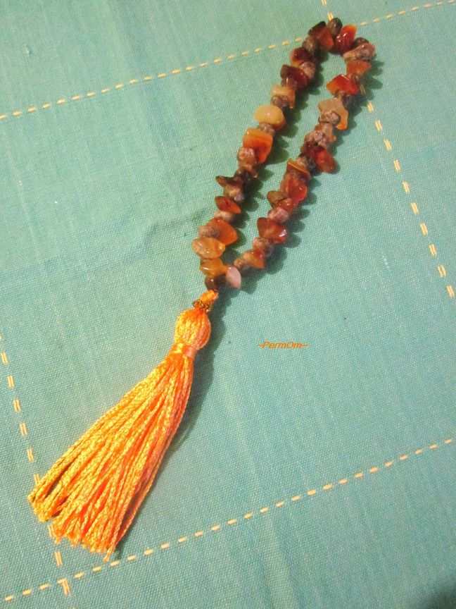 "A wrist mala made with 25 rough almandine garnets and 25 orange chalcedonies. This is the I am Happy mala.  You can choose a simple affirmation to pray with your mala like .""I am happy,  beautiful and strong and enjoy a healthy and passionate life"" It is made also for sacral chakra healing."