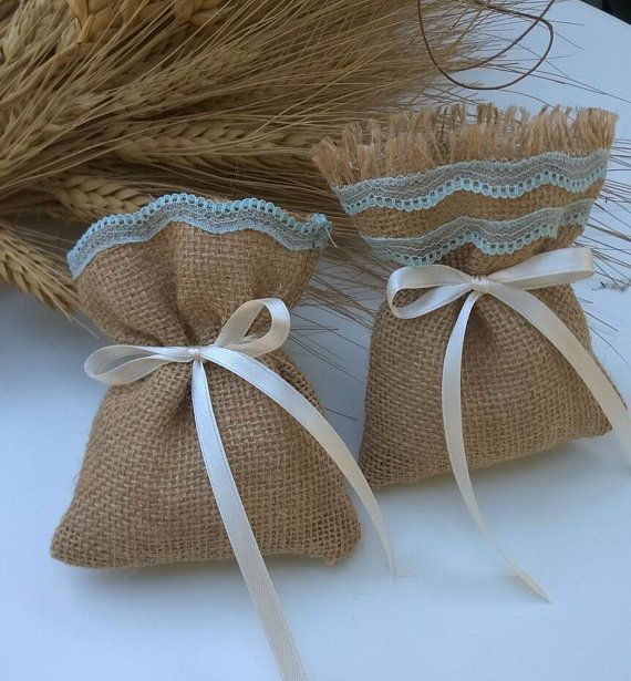 Burlap favour bags with turquoise ribbon