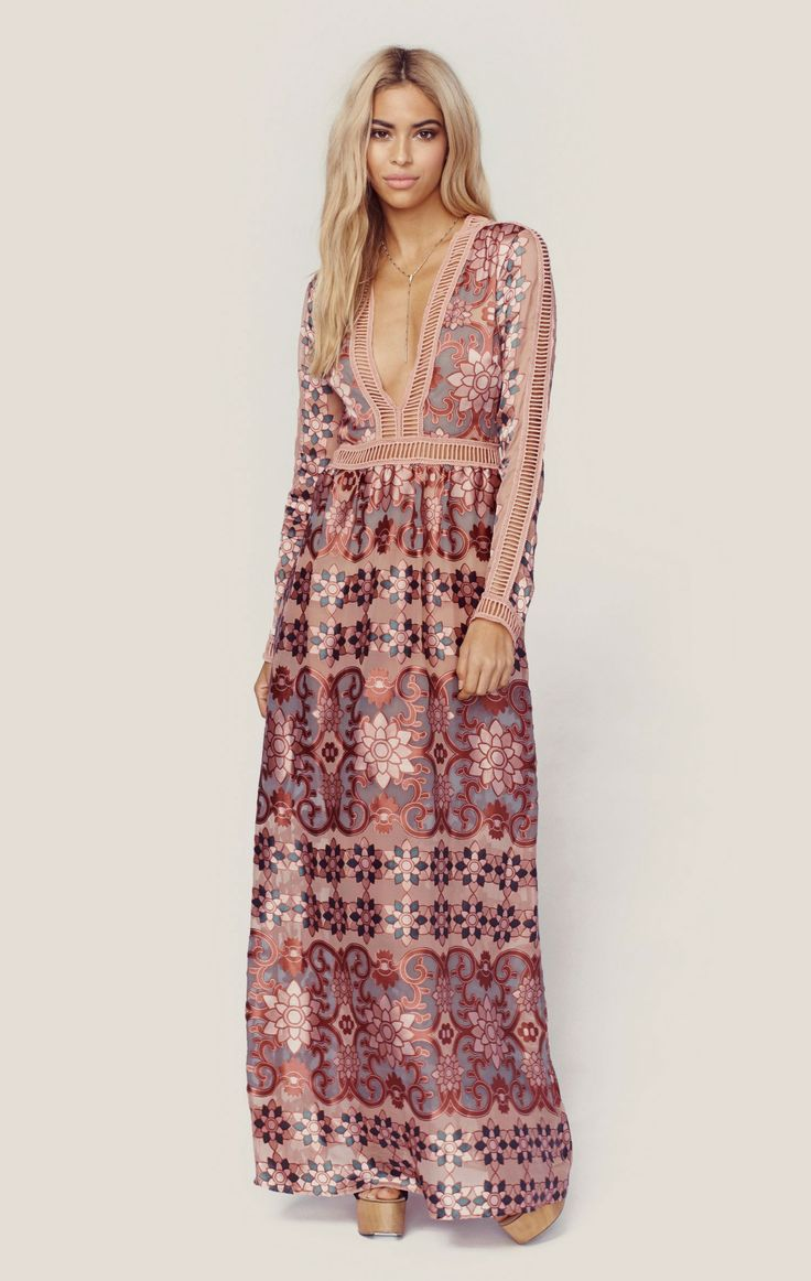 The Juliet Maxi Dress by For Love and Lemons is a vision with the brand's signature floral print on a silk satin burnout, mini ladder cut-out trim, nude bodysuit lining with deep v neckline, and flowi