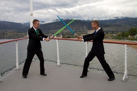 Groom + Groom duke it out with light sabers, on the SS Sicamous! Photography by Corinne Boback (based in Kelowna, BC)