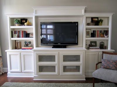 "Love the entertainment center. DIY with a stock 60"" base cabinet, two 30"" uppers on the floor, then shelves, molding and paint."