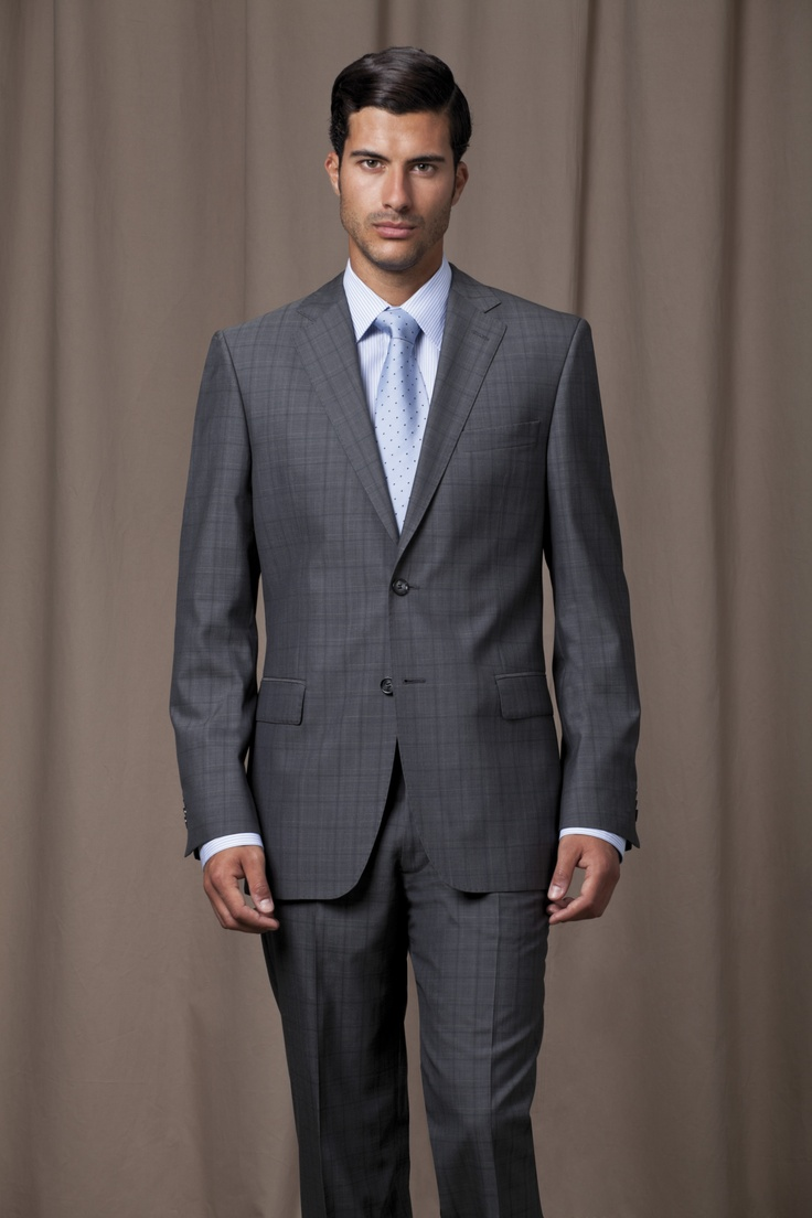 Grey, checked suit with powder blue shirt and matching silk tie