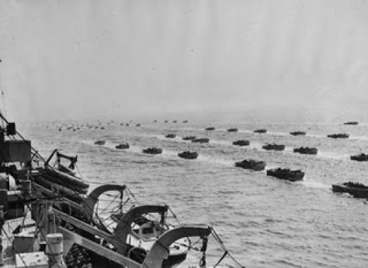This is a picture of the forces that invade normandy, the picture is taken probably form a battleship, and the smaller boats carried the infantry who stormed the beach