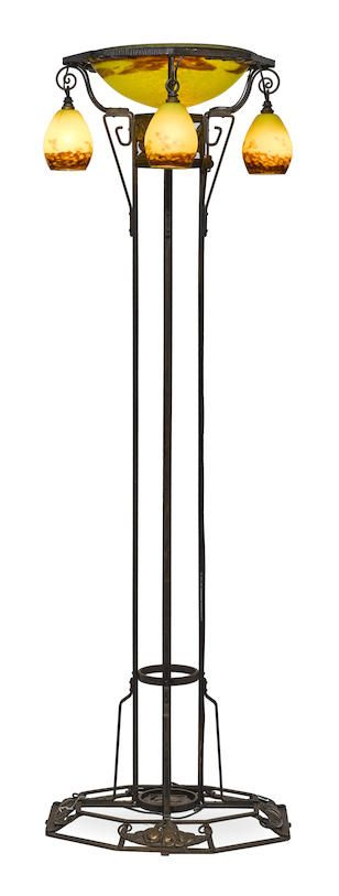 A French Art Deco Wrought Iron and Bronze Torchère with Mottled Glass Dhades, circa 1925.