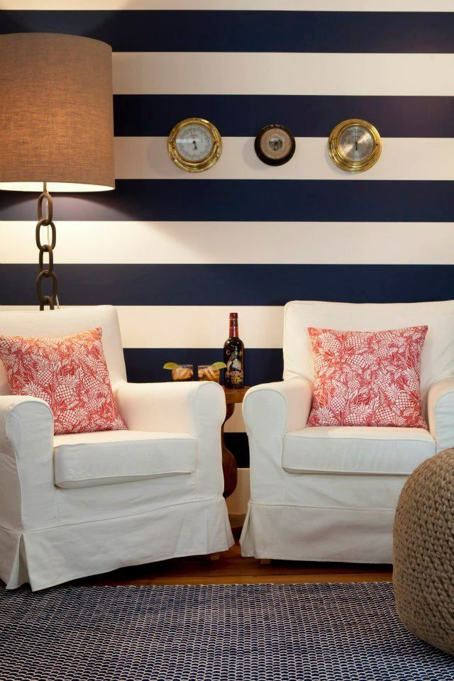 We love a good theme. Bring touches a favorite vacation or seaside beach trip to your home. Updating a space around a theme is an easy way to design a room but don't go overboard with accents. We loved this nautical inspired room with navy blue stripes, rope inspired area rug and accent pouf paired with anchor-inspired accent light. Easy to see how a few simple elements evoke the spirit of your theme with color, texture and decorative finds.