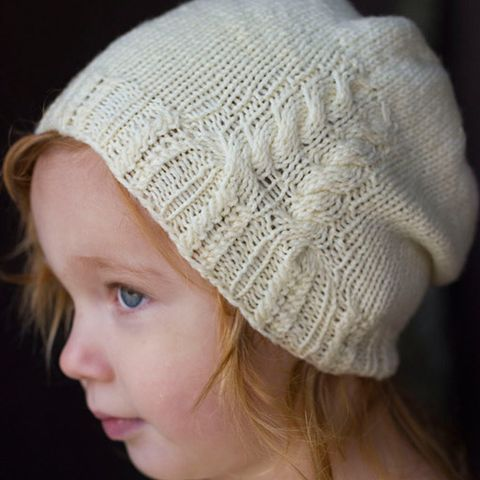 This is a printed pattern that requires shipping. Simple and sweet, with just a hint of cabling, this baby hat will keep your little one warm and cute all year round. SIZING: Premie (3, 6, 12, 24 mont