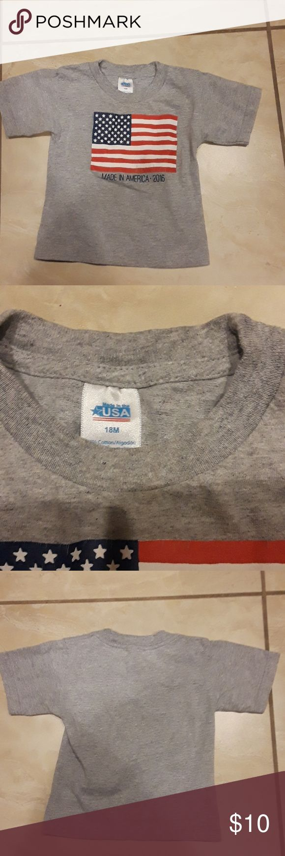 MADE IN AMERICA 2016 TEE SIZE 18 MONTHS MADE IN AMERICA 2016 TEE SIZE 18 MONTHS GREY WITH A PICTURE OF THE AMERICAN FLAG. WORN ONLY ONCE - IN PERFECT CONDITION. WILLING TO BUNDLE WITH SELECT ITEMS AND PRICE IS ALWAYS NEGOTIABLE! usa Shirts & Tops Tees - Short Sleeve