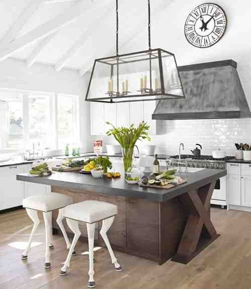 Eclectic kitchen down to the horse legged stools. Would never do this but worth pinning for the island counter and range hood.