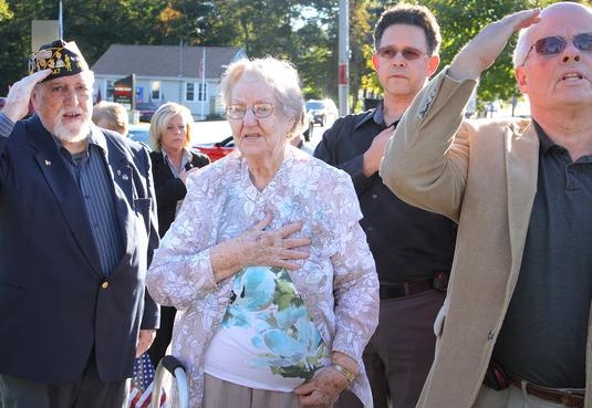 """Angela Keller, 92, leads the reciting of the """"Pledge of Allegiance"""" during the """"fallen hero"""" ceremony held on Sunday, Sept. 23, 2012, at the intersection of Hingham and Webster streets in Rockland.  GARY HIGGINS/The Patriot LedgerThe intersection was named Pfc. James M. Keller Square to honor her son James, who was killed in Vietnam in 1970.: Photo"""