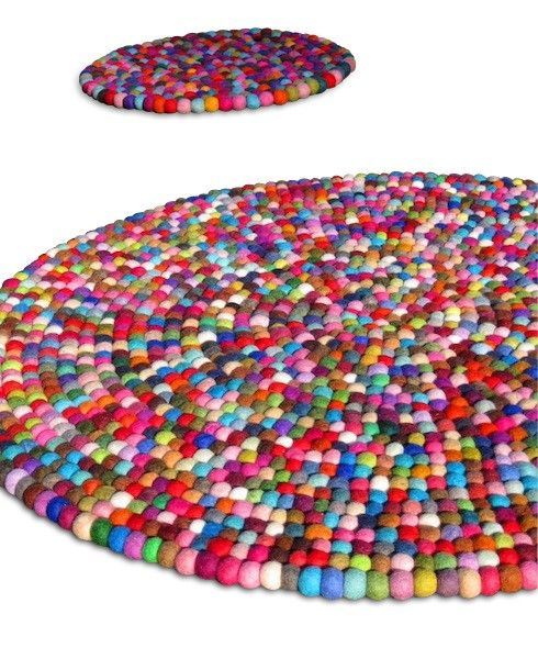 Wow! Rug made from felt balls, very cool!  Wonder if this could be scotchguarded after to protect it...