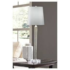 Long and lean with an alluring touch of sheen, this lamp is contemporary style taken to new heights. Space-sparing tapered profile and speckled brilliance make Ardara all the more striking.<br>  Signature Design by Ashley is a registered trademark of Ashley Furniture Industries, Inc.