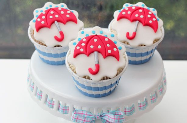 Umbrella cupcakes...this would be perfect for a baby shower and if mastered just right, a bridal shower! Love it!