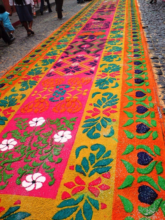 The Colorful Street Carpets of Semana Santa, in Antigua - In some Central American countries like Guatemala and Honduras, Semana Santa, or Holy Week, is celebrated in a colorful fashion, by creating beautiful street carpets made of sand and sawdust and decorated with plants and flowers, called alfombras. And nowhere are they most beautiful than in Antigua. | #Art #Festival #Installation #SandPainting #Places |