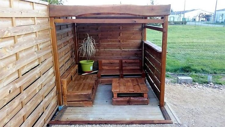 To spend a romantic evening of coffee cup with your loved ones, this splendid idea of wood pallet garden creation is excellent for you. Here you can capture the stylish shed or hut type of furniture house as placed in one corner of the garden. Its furniture is shaded with the dark chocolate brown shade of color.