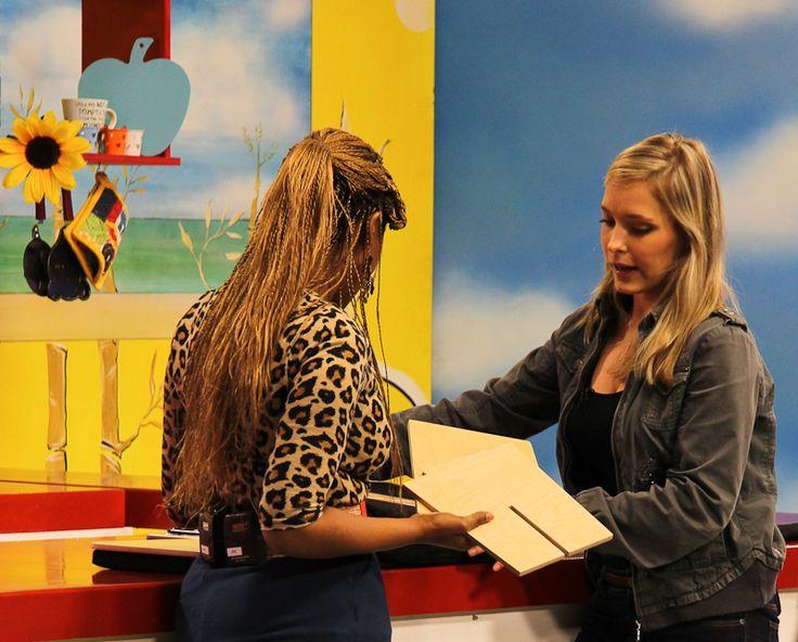 BLC Exhibitor Nicky van den Aardweg shows Lesego her entry, My Tova — at Hectic Nine-9 Studios. #BLCExhibitor #BLCShowcase #BLConHectic www.betterlivingchallenge.co.za