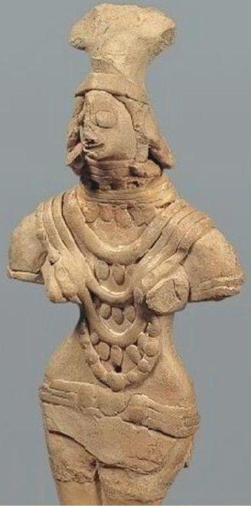 Female figure with headdress and jewelry. Harappa, 2,600-1,900 B.C.E.