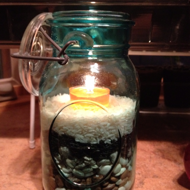 Candle holders I made from jars my daughter gave me and rice and beans.  Looks great in my kitchen!